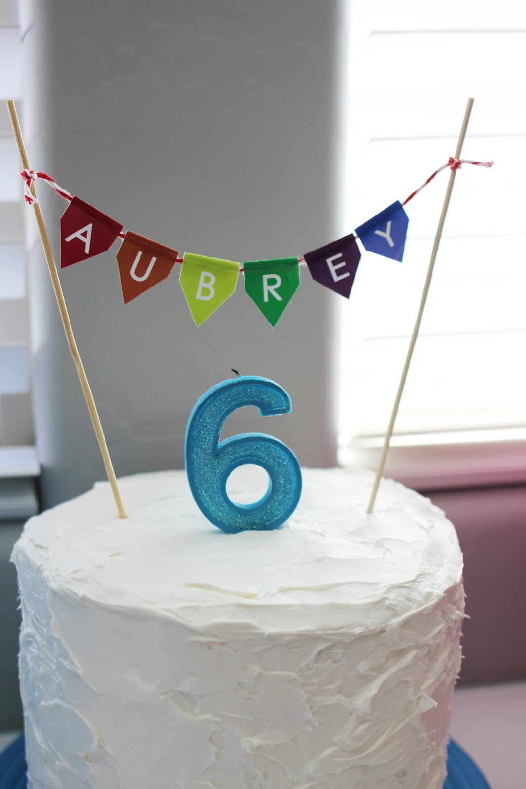 Of White Vanilla Pillsbury Frosting And Kept It Simple By Printing My Own Little Cake Banner With Daughters Name In Rainbow Colors A 6 Candle